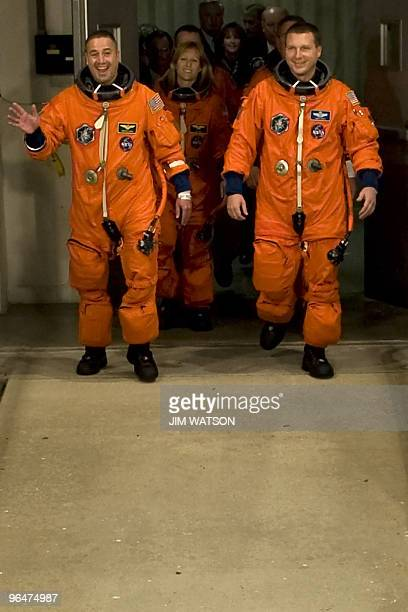 Commander George Zamka waves as the crew of the space shuttle Endeavour STS130 walk out to the astrovan at Kennedy Space Center in Florida on...
