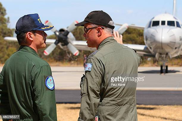 Commander Hidetsugu Iwamasa of the Japanese Maritime Self Defence Force talks with RAAF Group Commander Craig Heath before a Japanese P-3 Orion...