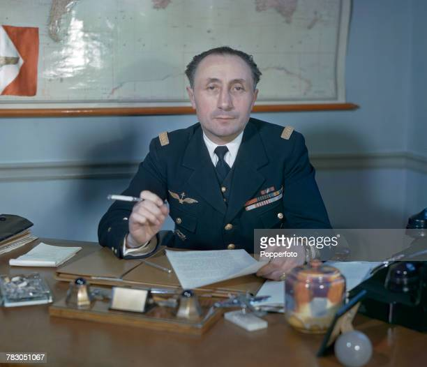 Commander in Chief of the French Air Force General Martial Henri Valin pictured wearing military uniform sitting at a desk in London in February 1943