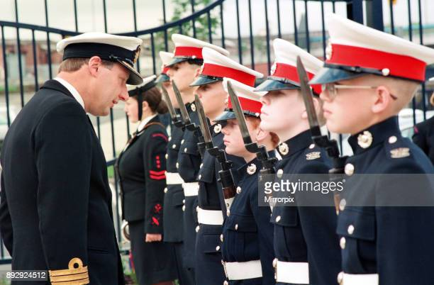 Commander J Robertson inspects the guard of honour provided by the Marines detachment when he made his annual inspection of TS Fortitude the Stockton...