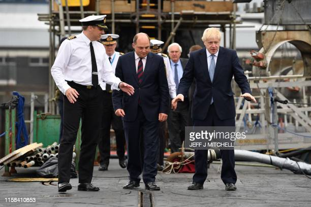 Commander Justin Codd chats with Britain's Prime Minister Boris Johnson and Britain's Defence Secretary Ben Wallace aboard Vanguardclass submarine...