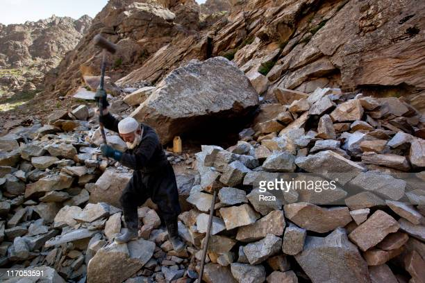 Commander Mir Nassir a former mudjahid of Commander Massoud's who is working today as a stonecutter at a quarry May 14 2009 in the Parandeh Valley...