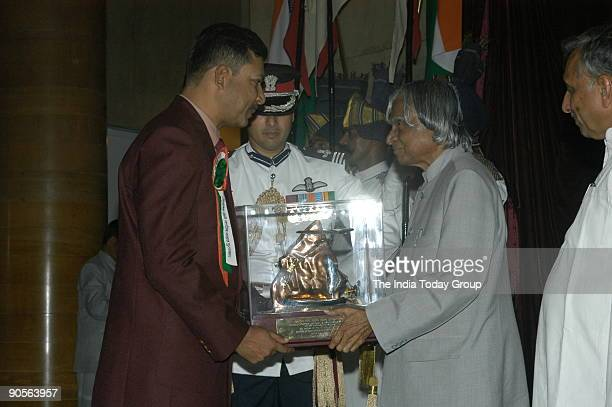 Commander Mukul Asthana Receiving the Tenzing Norgay National Adventure Award from APJ Abdul Kalam President of India at Sports and Adventure...