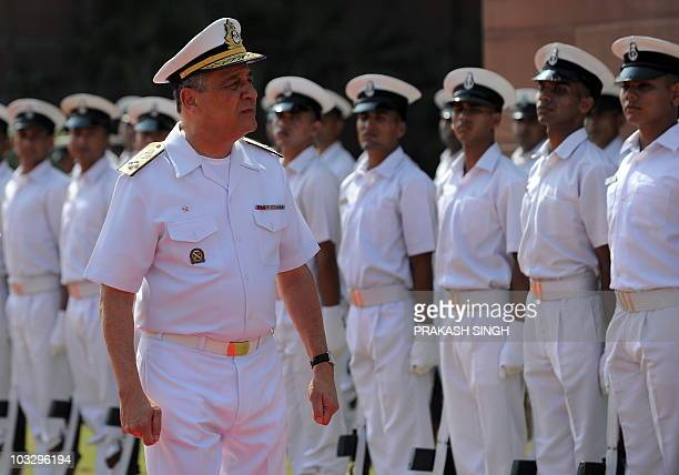 Commander of Brazilian Navy Admiral Julio Soares De Moura Neto inspects a guard of honour prior to his meeting with Indian Navy Chief Admiral Nirmal...