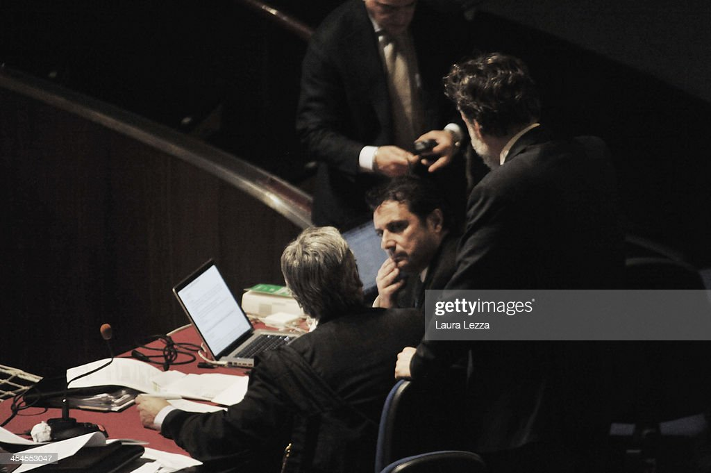 Commander of Costa Concordia Captain Francesco Schettino (2nd L) speaks with his lawyers during the hearing in the trial of the Costa Concordia on December 9, 2013 in Grosseto, Italy. Coastguard Captain Gregorio De Falco and Captain Francesco Schettino met for the first time in court today. De Falco, famous for ordering Schettino back onboard after he allegedly abandoned the ship with hundreds of passengers still onboard, took to the stand as a witness. The Costa Concordia capsized on January 13, 2012 leaving 32 people dead.