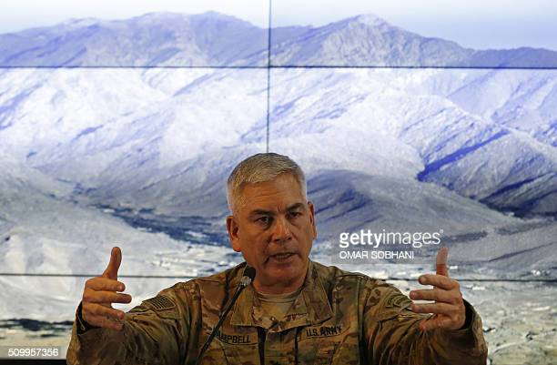 Commander of international and US forces in Afghanistan US Army General John Campbell speaks during a news conference at the Resolute Support...