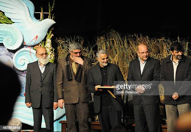 Commander of Iran's Qods Force Qassem Soleimani and Tehran Mayor Mohammad Baqer Qalibaf prepare to give an award to family members of a Qods Force...