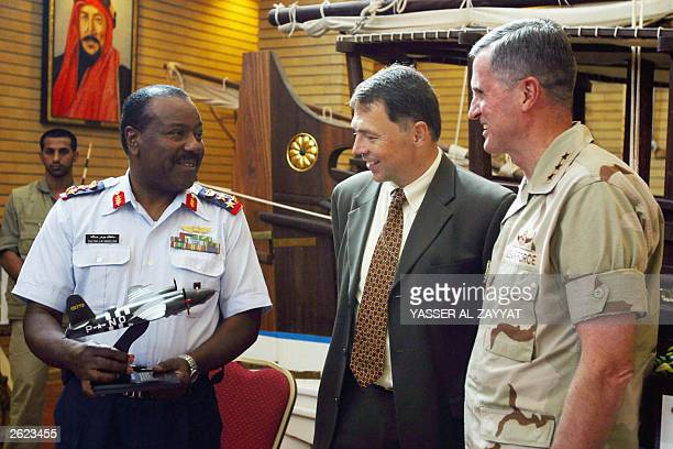 Commander of Kuwait's Ahmad AlJaber Air Base Brigadier Sultan Jawhar receives 21 October 2003 a memorial gift from Lt Gen Walter Buchanan commander...