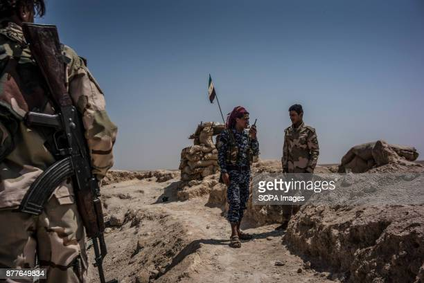 A commander of Quwat Al Nukhba listens to news over the radio if the ISIS has moved and position in front lines of Al Shaddadi desert close to Deir...