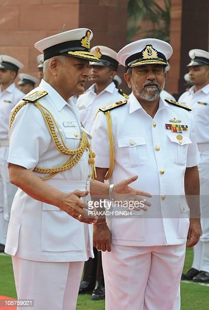 Commander of Sri Lanka's Navy Vice admiral Thisara Samarasinghe talks with Indian Navy Chief Admiral Nirmal Verma in New Delhi on October 20 2010 AFP...
