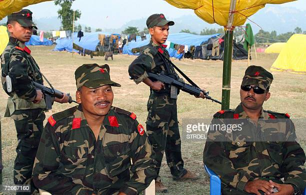 Commander of the 1st division of Nepals Maoist rebels Parwana as Assistant Commander Pawell looks on gives a briefing on the agreement signed between...