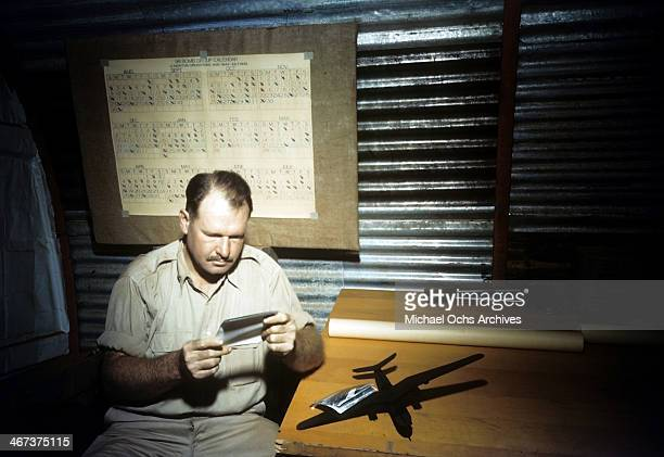 A commander of the 98th Bombardment Group inspects a photograph at the US Air Force Base in Benghazi Libya