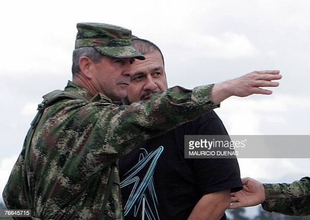 Commander of the Colombian Army General Mario Montoya shows the way to Drug Lord Diego Montoya Sanchez aka Don Diego after being flown from where he...