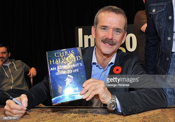 Commander of the International Space Station Chris Hadfield signs his new book 'An Astronaut's Guide to Life On Earth' at Indigo Manulife Centre on...
