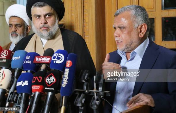 Commander of the Popular Mobilization Forces and leader of Fatah's electoral alliance Hadi alAmiri speaks during a joint press conference held with...