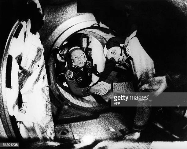 Commander of the Soviet crew of Soyuz Alexei Leonov and commander of the American crew of Apollo Thomas Stafford shake hands 17 July 1975 in the...