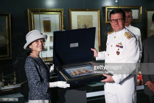 Commander of the Turkish Naval Forces Adnan Ozbal presents a gift to Japanese Princess Akiko of Mikasa attend a ceremony held for delivery of the...