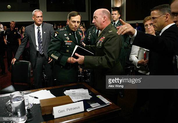 Commander of the United States Central Command Army Gen David Petraeus is escorted away after he collapsed while testifying during a hearing before...