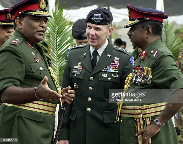 Commander of the US Army in the Pacific Lieutenant General James L Campbell and Sri Lankan AirForce Chief Donald Perera speak with local military...
