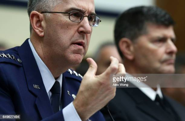 Commander of the US Strategic Command Air Force Gen John Hyten and Vice Chief of Naval Operations Adm Bill Moran testify during a hearing before...