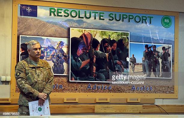 Commander of US and NATO forces in Afghanistan General John F Campbell stands before a press conference at Resolute Support headquarters in Kabul on...
