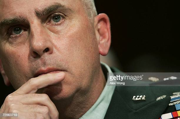 Commander of US Central Command Army Gen John Abizaid listens to questions as he testifies during a hearing before the Senate Armed Services...