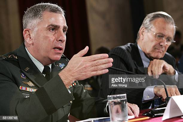 Commander of US Central Command Gen John Abizaid speaks as Secretary of Defense Donald Rumsfeld listens during a hearing before the Senate Armed...