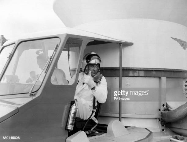 Commander Peter Lamb SaundersRoe test pilot in the driver's cab of the prototype of the allBritish SR N1 hovercraft designed by Christopher S...