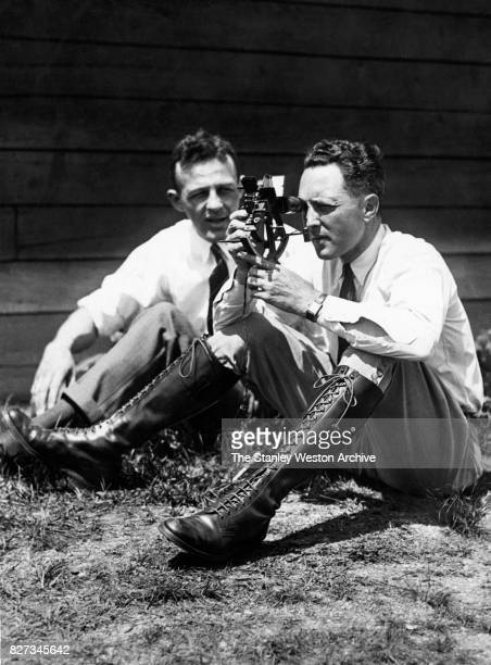Commander Richard E Byrd of the United States Navy looks through his sextant while his assisteant looks on as they wait for weather to clear before...