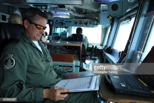 Commander 'Rocky' Salmon Commander Air on HMS Ark Royal known as Wings controls the flight deck during Exercise Auriga on July 14 2010 at sea in...