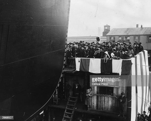 Commander Sir Charles Craven of the VickersArmstrong shipyard in BarrowinFurness presides over the launch of the new Orient liner Orion The customary...