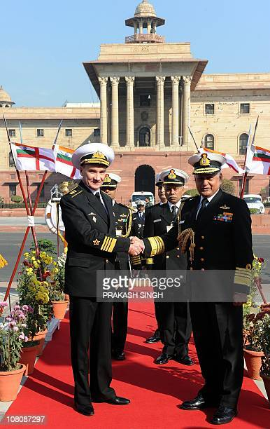CommanderinChief of Russian Navy Admiral Vladimir Vysotsky shakes hands with Indian Chief of Naval Staff Admiral Nirmal Verma prior to a meeting in...