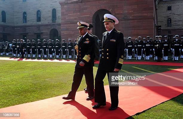 CommanderinChief of Russian Navy Admiral Vladimir Vysotsky walks next to Indian Chief of Naval Staff Admiral Nirmal Verma after reviewing the guard...