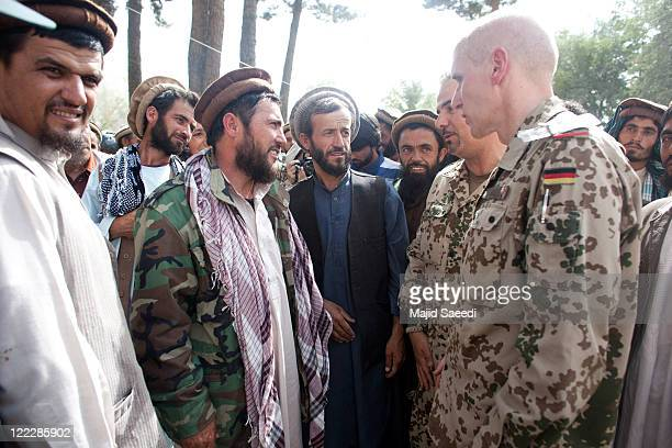 NATO commanders talk with Tailban leaders as more than 100 members of the Taliban surrender themselves to the Afghan Government on August 26 2011 in...