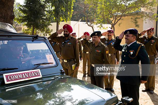 Commanding as well as noncommanding officers of The Presidential Bodyguard regiment or PBG salute their Commander in Chief as he arrives to inspect...
