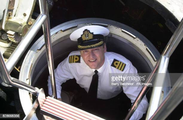 Commanding Officer Commander Andy McKendrick onboard the nuclear powered submarine HMS Turbulent as she returns to the Devonport Naval base Plymouth...
