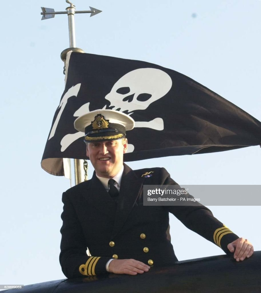 Commanding Officer Commander Andy McKendrick With The Jolly Roger Flag On  HMS Turbulent A Nuclear