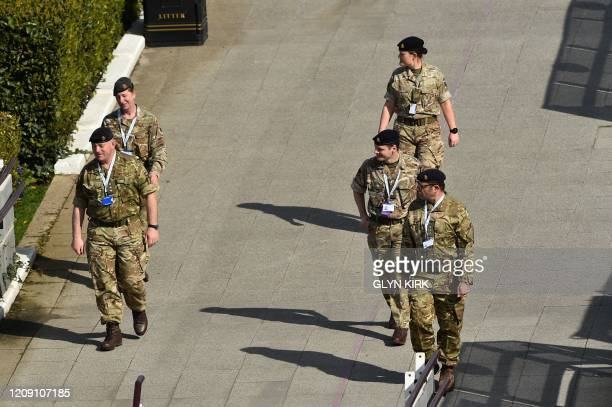 Commanding officer of 256 City of London Field Hospital Colonel Ashleigh Boreham and members of the armed forces patrols the perimeter at the ExCeL...