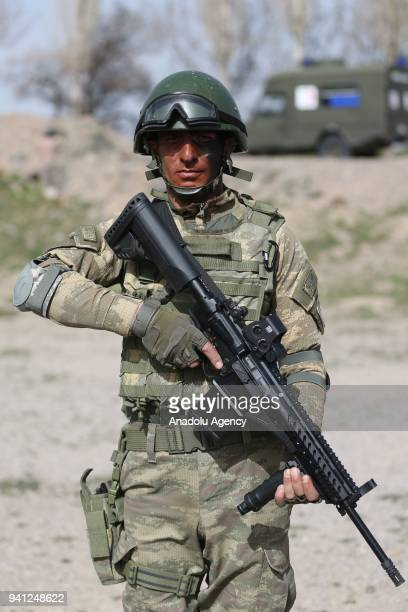A commando holds the Turkish Infantry Rifle MPT76 designed by MKEK during a training exercise at 1st Commando Brigade in Kayseri Turkey on April 03...