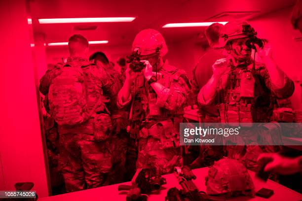 Commando Royal Marines prepare before heading from RFA Lyme Bay on a night time raid as part of exercise 'Saif Sareea 3' on October 23 2018 in the...