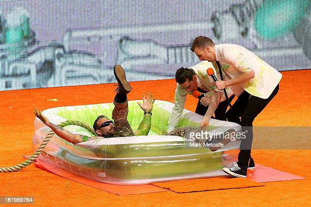 Commando' Steve Willis is slimed during the Nickelodeon Slimefest 2013 matinee show at Sydney Olympic Park Sports Centre on September 27, 2013 in...