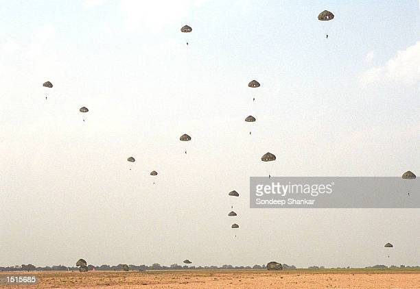 Commandoes of the Indian Air Force drop from a U.S. Air Force Hercules C-130 aircraft, part of joint exercises by the two nations October 22, 2002 at...