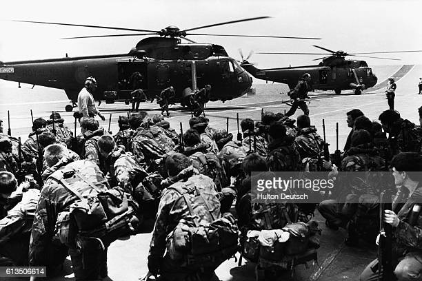 Commandos aboard the HMS Hermes prepare to be transferred to other ships to await deployment to the Falkland Islands
