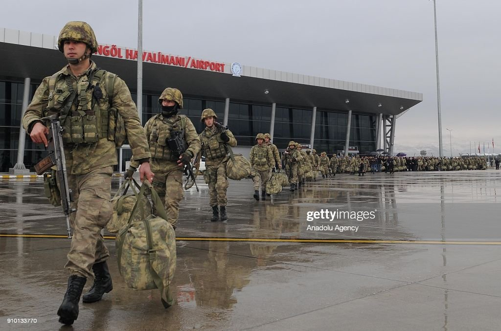 Commandos, dispatched to Afrin to take part in 'Operation Olive Branch', walk to get on a Turkish Air Force plane at Bingol Airport in Bingol, Turkey on January 25, 2018. Total of 200 commandos were dispatched. Turkey launched Operation Olive Branch on January 20, 2018 at 5 p.m.(1400GMT) in Syrias northwestern Afrin region; the aim of the operation is to establish security and stability along Turkish borders and the region as well as to eliminate PKK/KCK/PYD-YPG and Daesh terror groups, and protect the Syrian people from the oppression and cruelty of terrorists.