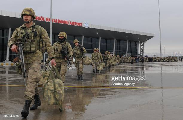 Commandos dispatched to Afrin to take part in 'Operation Olive Branch' walk to get on a Turkish Air Force plane at Bingol Airport in Bingol Turkey on...