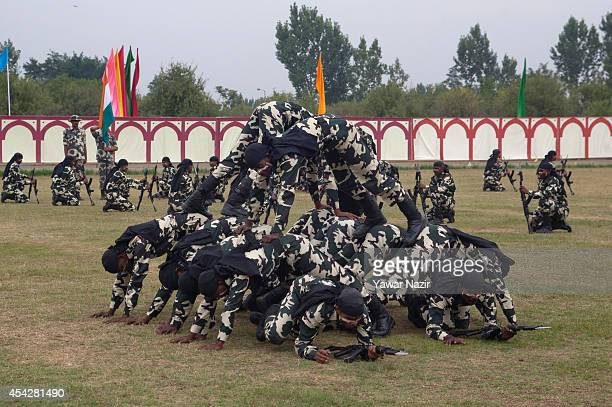Commandos of Indian Central Reserve Police Force Constables show their skills after the passing out parade on August 28 2014 in Humhama on the...