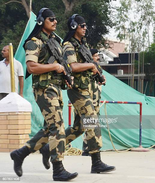 BSF commandos on alert during the Beating Retreat Ceremony at Attari Border on September 19 2016 in Amritsar India Each day more than 30000 people...