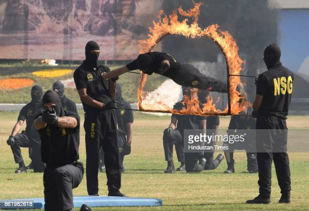 NSG commandos reenact their counterterrorism operations in the terror attacks during a function to celebrate the 33rd NSG Raising Day at Manesar...