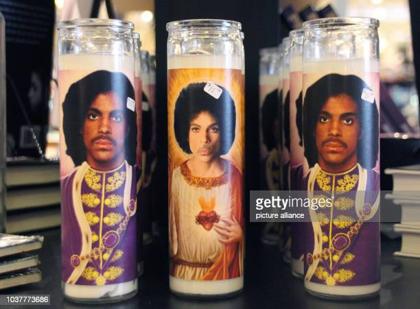 Commemorative candles with the picture of the musician Prince in the 'Electric Fetus' record store in Minneapolis Minnesota USA 13 April 2017 On...