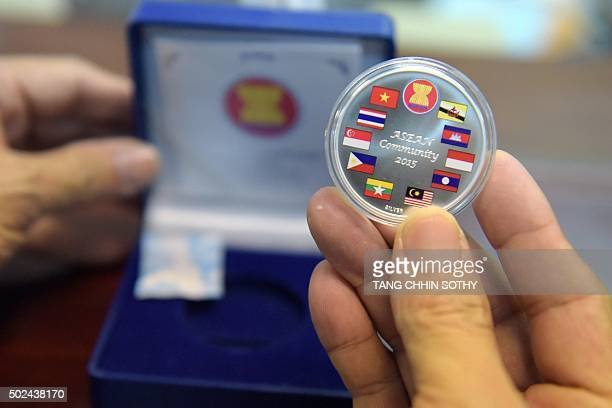 A commemorative coin with flags of ASEAN member countries is seen at the National Bank of Cambodia on December 25 2015 The National Bank of Cambodia...